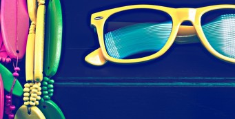 Image of bright yellow sunglasses and beads