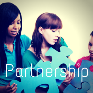 Image of three girls fitting large blue puzzle pieces together